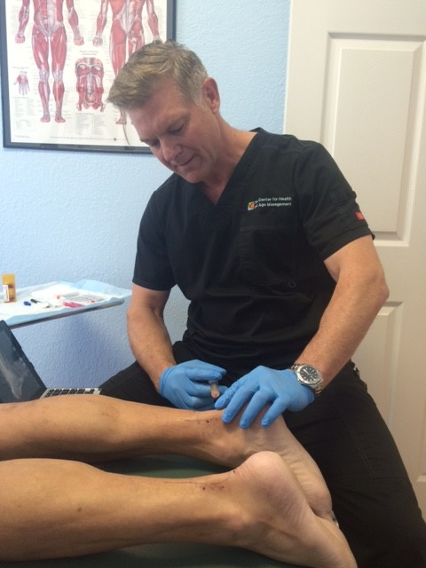 Dr. Heim injecting PRP (platelet rich plasma) injection to treat chronic Achilles tendinitis. Harnessing the body's natural ability to heal itself.