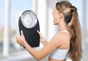 42012973 - dieting, weight scale, women.